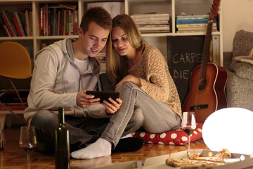 Boyfriend and girlfriend using tablet