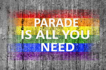 Parade is all you need and LGBT flag painted on background textu