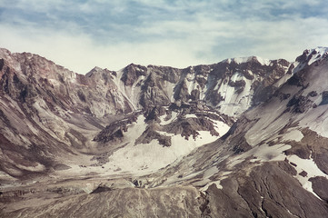 Mount Saint Helens in 1997 - Extreme closeup of Mt. St. Helens lit by evening sun. The dome in the volcano crater  (post May 18, 1980 eruption) can be seen. Grainy photo shot in July 1997 on film.