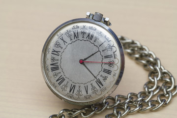 Pocket watch with Roman numerals.