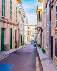 Wall Mural - View of an narrow mediterranean street