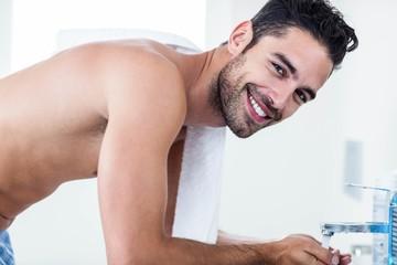 Man washing his face in sink