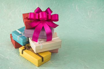 Colorful small gift box with bow