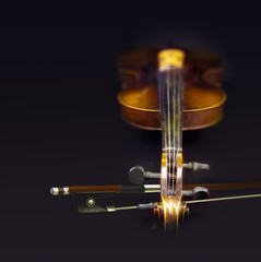 Old violin with fiddlestick