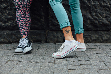 Teen with a tattoo on her leg