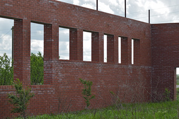 Abandoned building of red brick