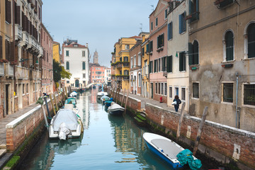 Famous Venetian water canals, historic houses and boats.