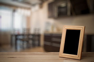 photo frame on the wooden table