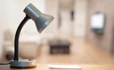 lamp and notebook on table