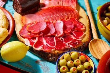 Tapas Iberico ham and lomo sausage olives