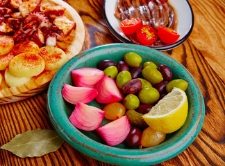 Olives onion pickles tapas anchovies and octopus