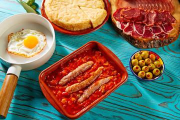 Tapas pisto con tomate ratatouille egg sausage