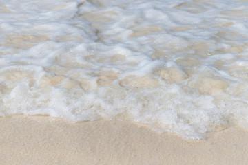 Wall Mural - Water splash at Phatong beach located Phuket province ,Thailand