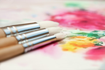 Paintbrushes over the paint background.