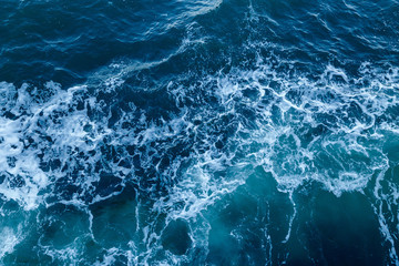 Blue sea texture with waves and foam