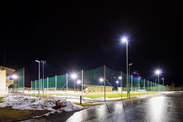 training soccer field with flood light at night in winter