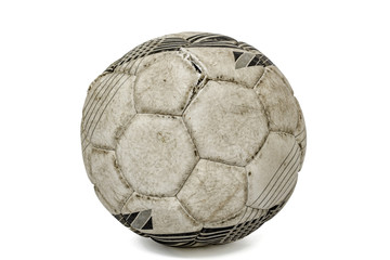 Old torn soccer ball, isolated on white background