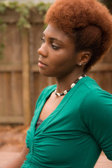 Pretty Woman with Orange Afro Mohawk Outside