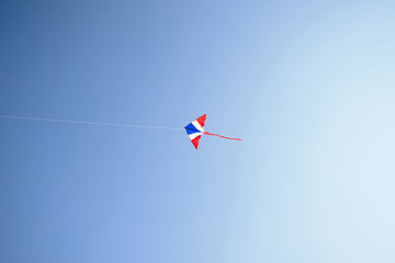 Kite flying in the wind and clear sky with copy space