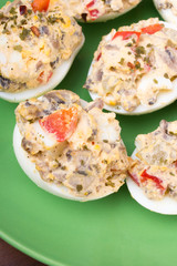 stuffed eggs with peppers, mushrooms and herbs - selective focus
