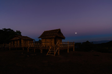 Thai style bamboo cottage with the moon background.