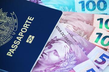 Brazilian passport with bills
