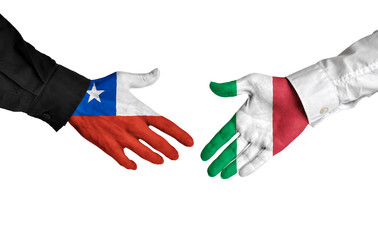 Chile and Italy leaders shaking hands on a deal agreement