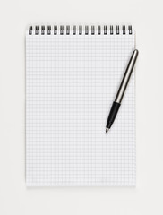 Top view of a notepad. Single object isolated on white background. Concept photograph with copy space. Writing or noting accessories theme.