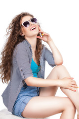 fashion portrait of sensual stylish woman on a white background