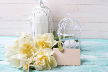 Background with fresh spring flowers, tag and candles in decorat