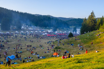 Swarms of people are gathering during Rozhen folklore festival in Bulgaria in rhodope mountains.