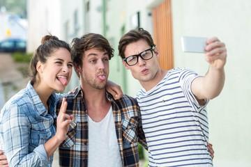 Hip friends taking selfie