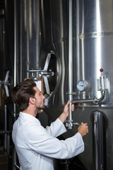 Brewer checking the vats