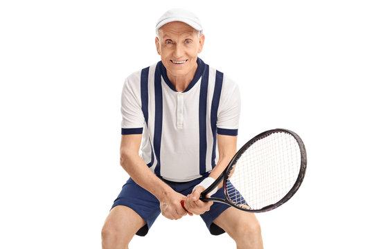 Cheerful senior playing tennis