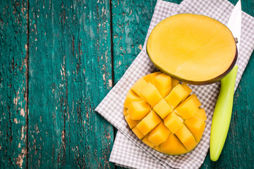 Image result for mango fruit on blue  wooden table