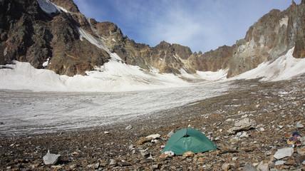 Green tent at glacier Greater Caucasus Mountain Range