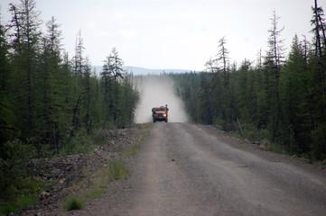 Truck at Chukotka gravel road taiga area