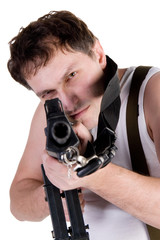 Portrait of a man aiming a gun (with focus on the man's face)