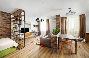 Interior studio apartments, with bookshelves and hardwood floors