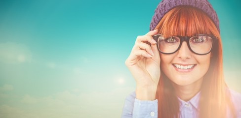 Composite image of smiling hipster woman looking at camera