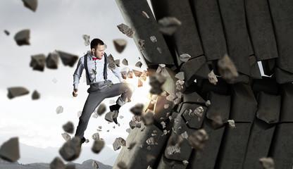 Businessman crashing bricks