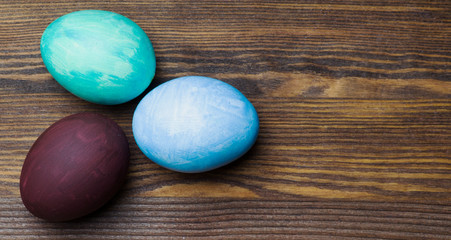 Easter eggs on a wooden table.
