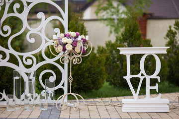 Beautiful stylish flower stand at wedding aisle closeup