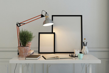 Empty picture frames on a writing desk