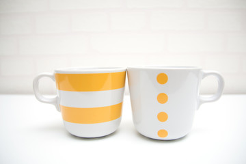 coffee cups on white table