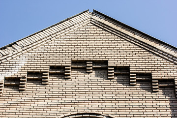 Old brick wall and roof detail.