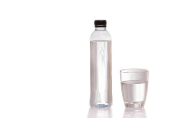 Drinking water in bottles and glasses on a white background.