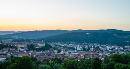 aerial view of romanian city sighisoara during sunset