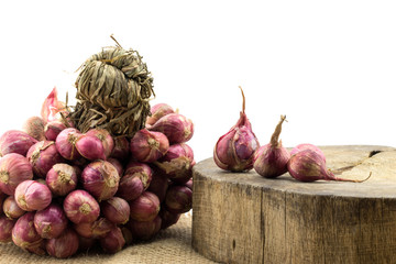 Shallot onions a group on old wood and isolated on white background