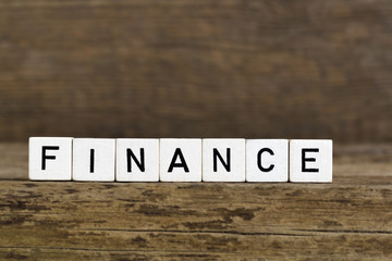 The word finance written in cubes